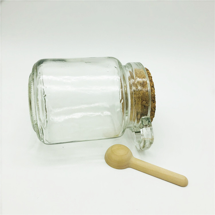 Custom  design glass honey jar glass honey bottle with wood spoon and tie plug