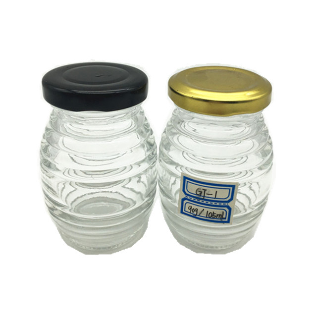 Exquisite thread design honeycomb shape 100ml honey glass jar with tin lid